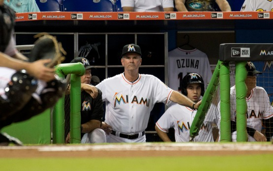 The Miami Marlins new manager Dan Jennings stands in the dugout during the second inning of a baseball game against the Arizona Diamondbacks in Miami, Monday, May 18, 2015.  (AP Photo/J Pat Carter)