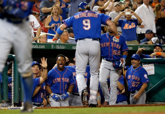 New York Mets' Kirk Nieuwenhuis (9) celebrates his home run as he returns to the dugout during the eighth inning of a baseball game against the Washington Nationals at Nationals Park, Tuesday, Sept. 8, 2015, in Washington. The Mets won 8-7. (AP Photo/Alex Brandon)