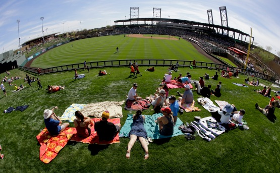 Fans soak in the sun during the sixth inning of a spring training baseball game between the Arizona Diamondbacks and the Colorado Rockies in Scottsdale, Ariz., Thursday, March 3, 2016. (AP Photo/Chris Carlson)