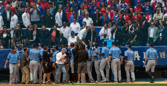 President Barack Obama greets Tampa Bay Rays players before a game with the Cuban national team in Havana, Cuba, Tuesday, March 22, 2016. The crowd roared as U.S. President Barack Obama and Cuban President Raul Castro entered the stadium and walked toward their seats in the VIP section behind home plate. It's the first game featuring an MLB team in Cuba since the Baltimore Orioles played in the country in 1999. (AP Photo/Ramon Espinosa)