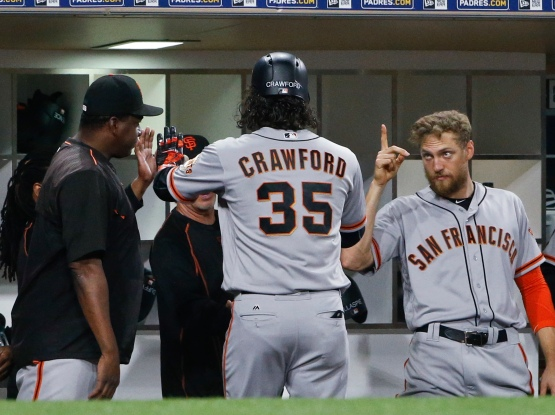 San Francisco Giants' Brandon Crawford is met by teammates, including Hunter Pence, right, after hitting a solo home run against the San Diego Padres during the seventh inning of a baseball game Thursday, May 19, 2016, in San Diego. (AP Photo/Lenny Ignelzi)