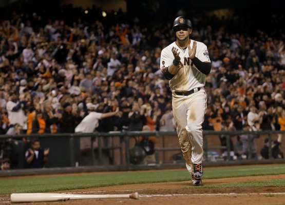 San Francisco Giants' Gregor Blanco scores against the Arizona Diamondbacks during the seventh inning of a baseball game in San Francisco, Wednesday, April 20, 2016. The Diamondbacks won 2-1. (AP Photo/Jeff Chiu)
