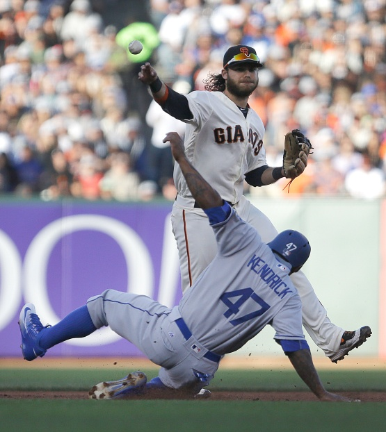 San Francisco Giants' Brandon Crawford throws over Los Angeles Dodgers' Howie Kendrick (47) to complete a double play in the fifth inning of a baseball game Sunday, June 12, 2016, in San Francisco. Dodgers' A.J. Ellis was out at first base on the play. (AP Photo/Ben Margot)