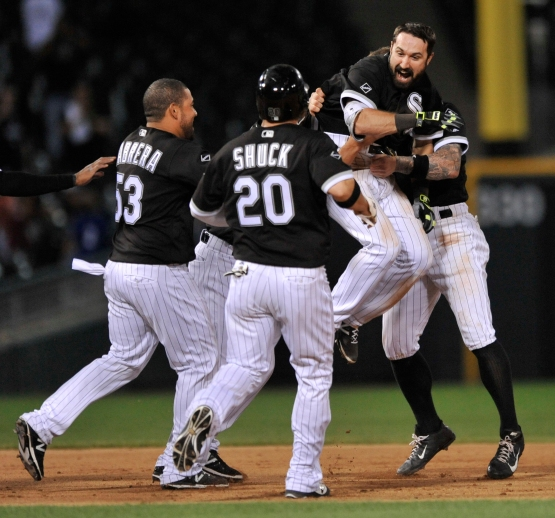 Chicago White Sox's Adam Eaton, top right, celebrates with teammates after driving in the winning run in the team's 10-9 win over the Detroit Tigers in 12 innings in a baseball game Monday, June 13, 2016, in Chicago. (AP Photo/Paul Beaty)