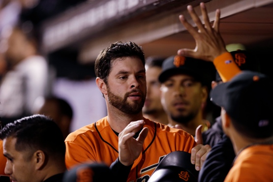 San Francisco Giants' Brandon Belt, center, is greeted in the dugout after scoring on a single by Angel Pagan during the seventh inning of a baseball game against the Philadelphia Phillies on Friday, June 24, 2016, in San Francisco. (AP Photo/Marcio Jose Sanchez)