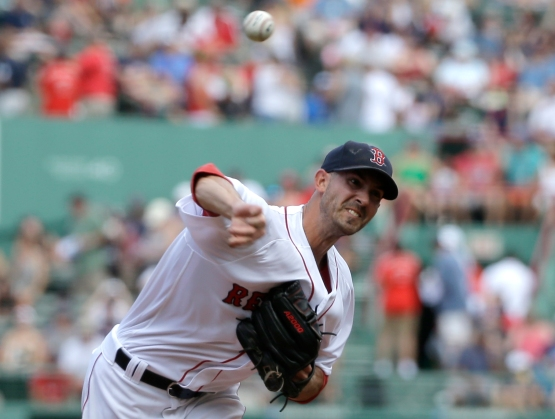Boston Red Sox's Rick Porcello delivers a pitch against the Arizona Diamondbacks in the first inning of a baseball game, Sunday, Aug. 14, 2016, in Boston. (AP Photo/Steven Senne)