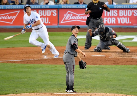 Los Angeles Dodgers' Corey Seager watches his three-run home run, along with Arizona Diamondbacks starting pitcher Zack Greinke, center, and catcher Welington Castillo during the fifth inning of a baseball game, Monday, Sept. 5, 2016, in Los Angeles. (AP Photo/Mark J. Terrill)